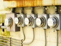 Fila de contadores eléctricos Fotografía de archivo