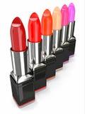 Fila de lápices labiales stock de ilustración