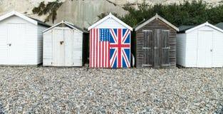 Fila de las chozas inglesas de la playa Imágenes de archivo libres de regalías