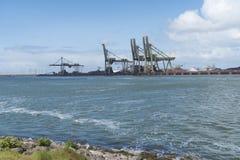Fila de las grúas del puerto Imagen de archivo libre de regalías