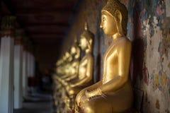 Fila de las imágenes de Buddha Imagen de archivo