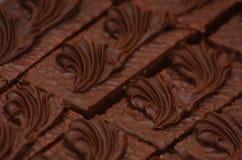 Fila de las tortas de chocolate Foto de archivo libre de regalías