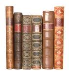 Fila de libros encuadernados de cuero viejos Foto de archivo