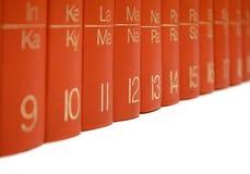 Fila de libros rojos Imágenes de archivo libres de regalías
