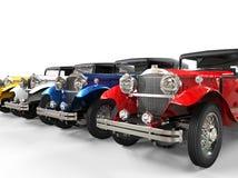 Fila de los coches coloridos del vintage Foto de archivo