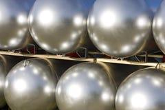 Fila de los tanques de plata Fotos de archivo libres de regalías