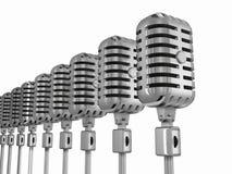 Fila de micrófonos Foto de archivo libre de regalías