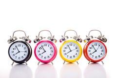 Fila de relojes de alarma Fotografía de archivo