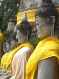 Fila de sentar la estatua de Buddha Fotografía de archivo libre de regalías