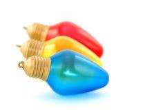 Fila de tres bulbos - azul en frente Foto de archivo libre de regalías