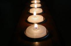 Fila de velas votivas Fotos de archivo libres de regalías