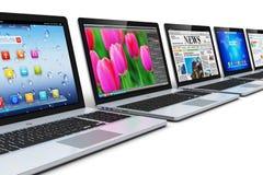 Fila dei computer portatili Fotografia Stock