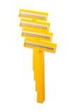Fila dei rasoi di sicurezza arancio Fotografie Stock Libere da Diritti