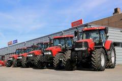 Fila dei trattori agricoli di caso IH Fotografia Stock