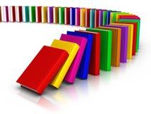 Fila del efecto de dominó colorido de los libros Imagenes de archivo