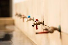 Fila del rubinetto Fotografie Stock