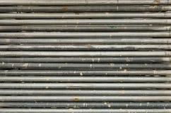 Fila dell'acciaio sporco dell'alluminio del tubo del cerchio Fotografia Stock Libera da Diritti