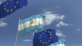 Fila delle bandiere d'ondeggiamento dell'Argentina e dell'Unione Europea UE, animazione loopable 3D archivi video