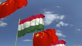 Fila delle bandiere d'ondeggiamento dell'Ungheria e della Cina, animazione loopable 3D archivi video
