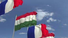Fila delle bandiere d'ondeggiamento dell'Ungheria e della Francia, animazione loopable 3D stock footage