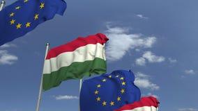 Fila delle bandiere d'ondeggiamento dell'Ungheria e dell'Unione Europea UE, animazione loopable 3D video d archivio
