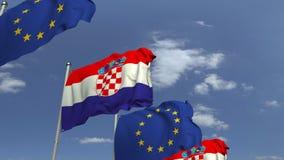 Fila delle bandiere d'ondeggiamento della Croazia e dell'Unione Europea UE, animazione loopable 3D video d archivio