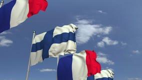 Fila delle bandiere d'ondeggiamento della Finlandia e della Francia, animazione loopable 3D archivi video