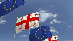 Fila delle bandiere d'ondeggiamento di Geogia e dell'Unione Europea UE, animazione loopable 3D archivi video