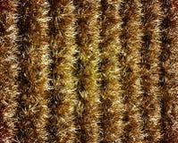 Fila delle ghirlande dorate Fotografia Stock