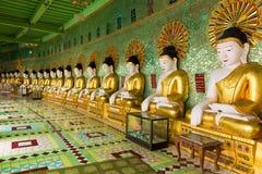 Fila delle statue di Buddha Immagine Stock