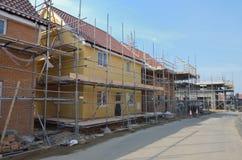 Fila di nuove case in costruzione Fotografia Stock