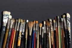 Fila di vecchie spazzole Fotografie Stock Libere da Diritti