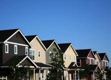 Fila multicolora de casas Imagen de archivo libre de regalías