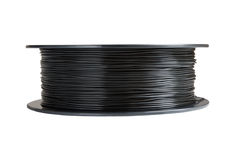 Filament for 3d printing. Black thermoplastic. Isolated on white background. stock photography