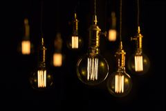 Filament lamps on black. Large filament hanging lightbulbs on black background Stock Photography