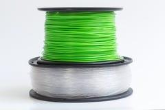Filament pour l'imprimante 3D clair comme de l'eau de roche et vert clair contre a Photos libres de droits