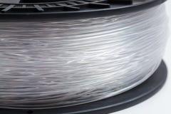 Filament pour le fond lumineux clair comme de l'eau de roche de l'imprimante 3D Photo stock