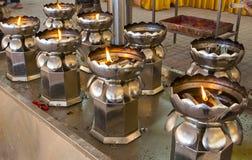 A filantropia da lâmpada de óleo para reza o deus imagem de stock royalty free