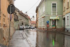 Filarmonicii street in a rainy day in Sibiu city in Romania. Sibiu, Romania, October 07, 2017 : Filarmonicii street in a rainy day in Sibiu city in Romania Stock Images