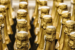 Filas de las botellas del champán Imágenes de archivo libres de regalías