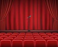 Filas de los asientos rojos del cine o del teatro delante de la etapa de la demostración libre illustration