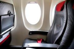 Filas de Seat en una cabina del aeroplano Imagen de archivo libre de regalías