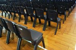 Filas de sillas Imagen de archivo libre de regalías