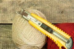 Filato e coltello Fotografie Stock