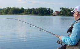 Filatura di pesca del pescatore Fotografie Stock