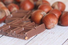 Filbert and chocolate on wooden background Royalty Free Stock Photos