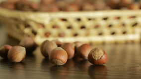 Filbert nuts. Placer in a wicker basket, close-up stock video footage