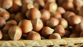 Filbert nuts. Placer in a wicker basket, close-up. Filbert nuts. Placer in a wicker basket stock video