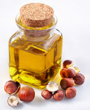 Filbert oil. With nuts on a white background Stock Image