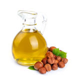 Filbert oil with hazelnuts nuts. Close up on white Royalty Free Stock Photos